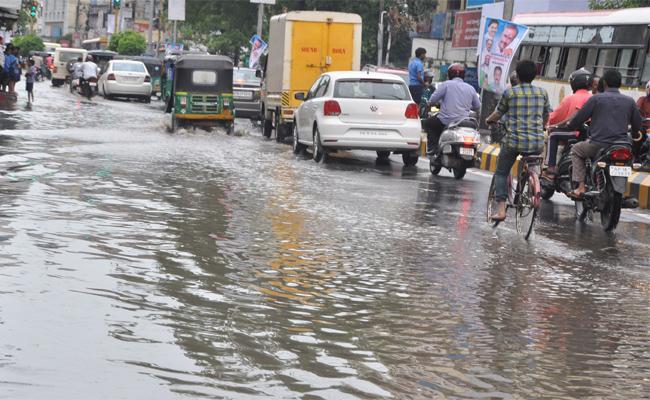 Heavy Rain Fall In vijayawada  - Sakshi
