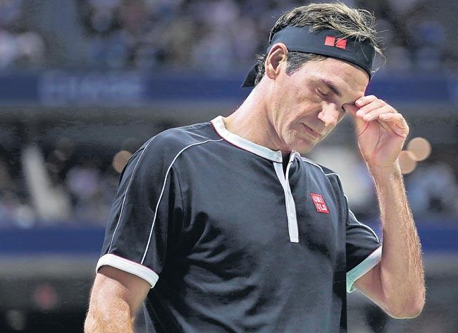 Roger Federer had another issue besides injury in US Open loss - Sakshi