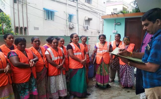 GVMC Sanitation Workers Wages Hikes - Sakshi