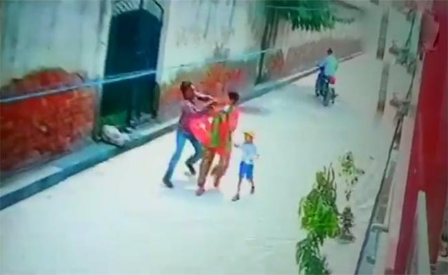 Two Motorcycle Borne Assailants Snatched chain from a Woman - Sakshi