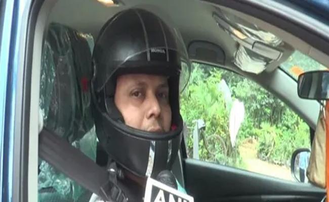 Aligarh Man Wearing Helmet While Driving Car After Get E Challan - Sakshi