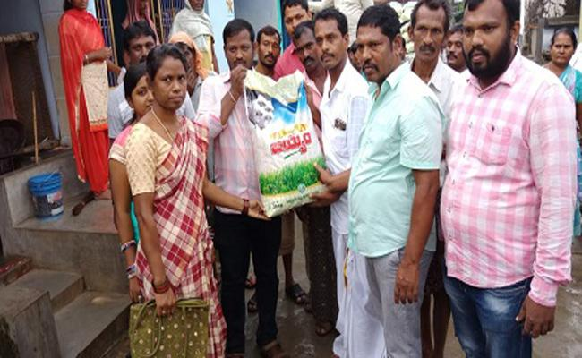 Grama Volunteer Distributed Rice Bags To Houses IN Srikakulam - Sakshi