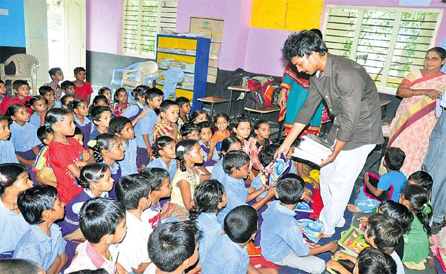 Young Man Helps Children Education in Hyderabad - Sakshi