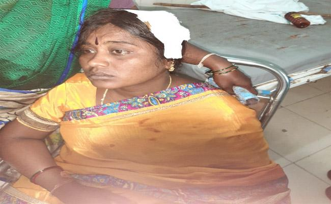Warangal Former Corporator Attacks Woman With A Stick - Sakshi
