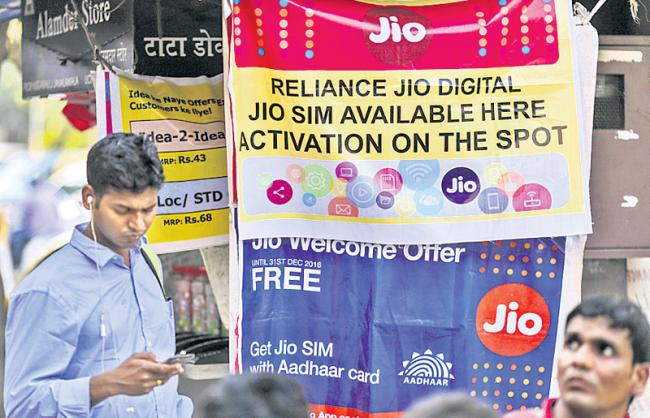 Reliance Jio to charge for voice calls made to other telecom operators - Sakshi