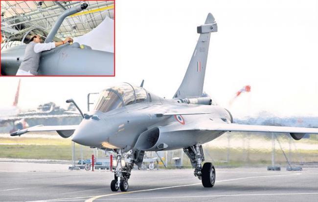 Rajnath Singh inducts first Rafale in IAF - Sakshi