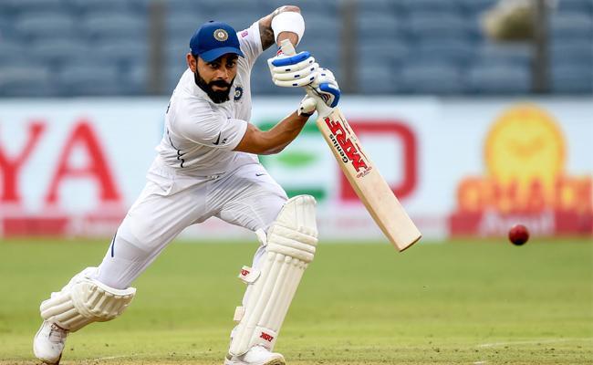 Virat Kohli Scored a Half-Century in the Second Test Against South Africa - Sakshi