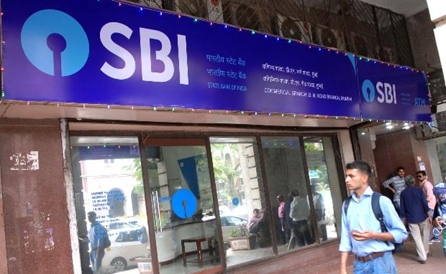 State Bank of India cuts lending rates by 10bps across tenures - Sakshi