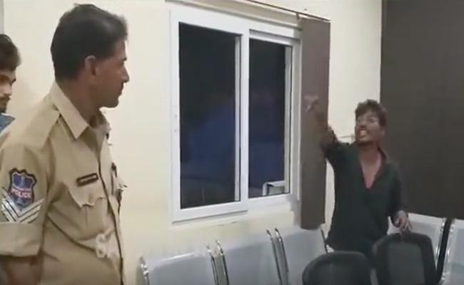 Drunk Man Fights with Police in sircilla - Sakshi
