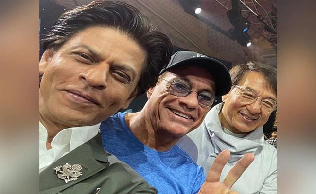 Shah Rukh Khan Poses With Jackie Chan Jean Claude Van Damme In Riyadh - Sakshi