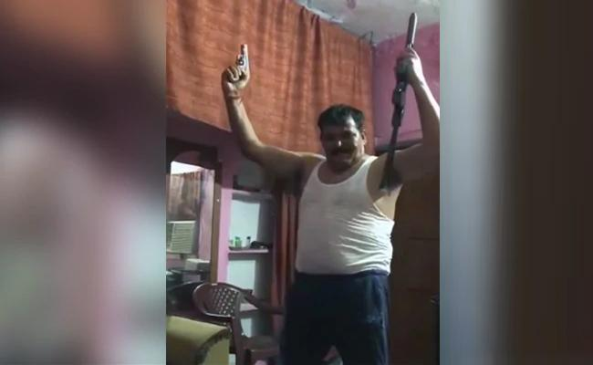 Probe Ordered After Video Shows Man Dancing With Two Guns - Sakshi