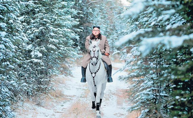 Kim Jong Un rides white horse up sacred mountain - Sakshi
