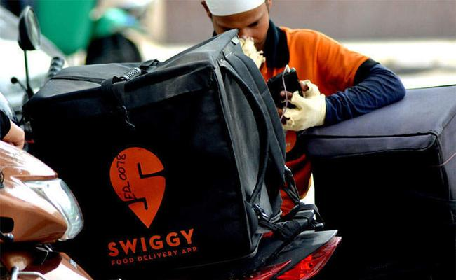 Swiggy plans to hire 3 lakh people in 18 months aims to become third-largest employer in country - Sakshi