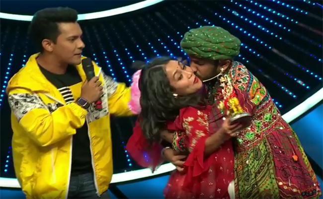 Neha Kakkar Left In Shock After Indian Idol 11 Contestant Forcibly Kisses Her on Stage - Sakshi