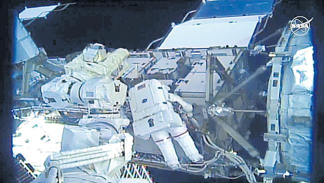 Nasa astronauts Christina Koch and Jessica Meir in all-women spacewalk - Sakshi