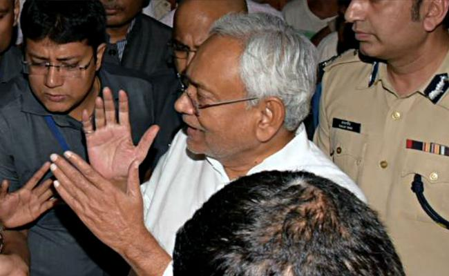 Bihar CM Nitish Kumar Fires On Journalist - Sakshi