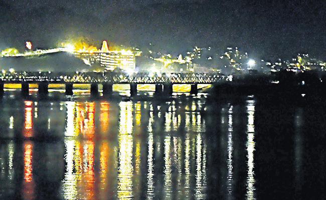 Vijayawada In The Night With lighting Effects along Krishna River - Sakshi