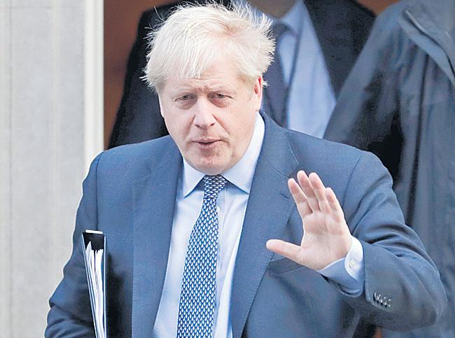 Brexit vote setback for Boris Johnson in Parliament - Sakshi