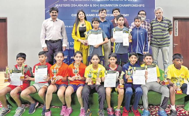 Sai Prasad And Prasamsa Wins Badminton Titles - Sakshi