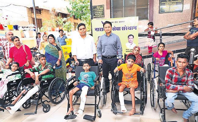 Social Service With Insta Cash For handicapped Children - Sakshi