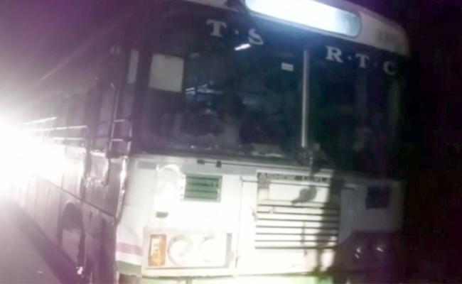 Two Buses Damaged In Adilabad - Sakshi