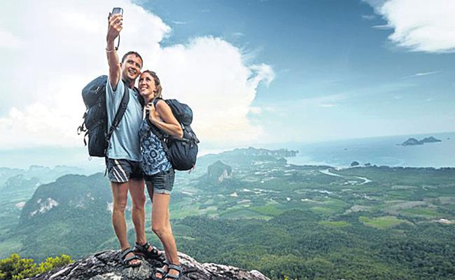 Most of People Using Smart Phone in Tour And Travels - Sakshi