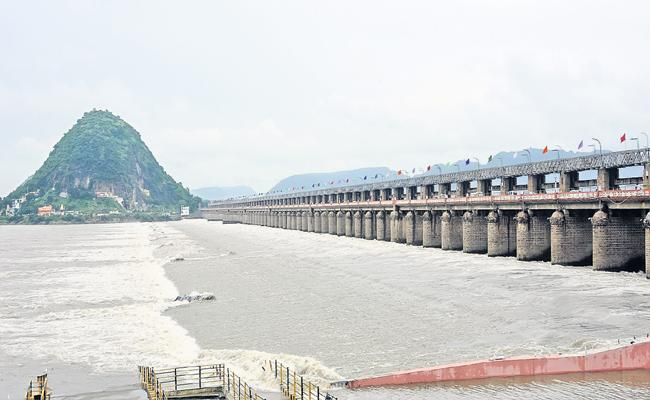Huge flood into Srisailam dam - Sakshi