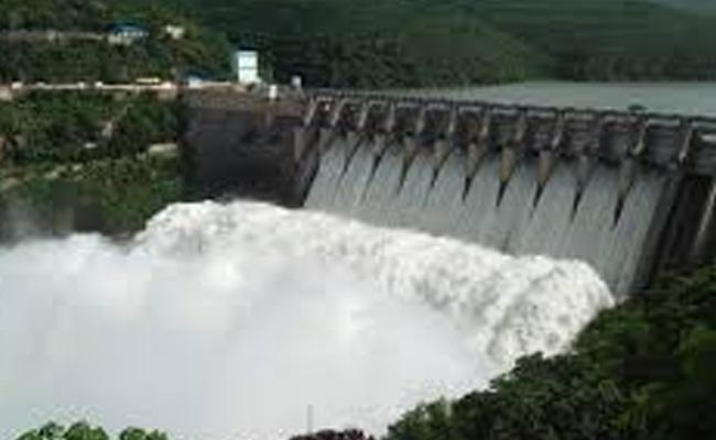 Record Water Flow In Srisailam Dam After 35 Years - Sakshi