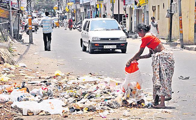 Teacher Was Fined For Leave Garbage On Road In Ranga Reddy District - Sakshi