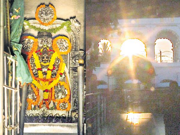 Devotees on Wednesday witnessed the spectacle of the first sun rays hit to Lord Suryanarayana  - Sakshi