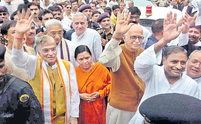 BJP Leaders Hand In Babri demolition case - Sakshi