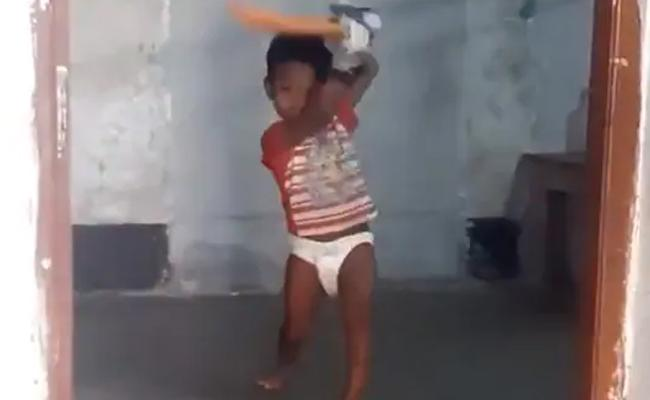 A Child In Diapers Plays Natural Cricket Shots - Sakshi