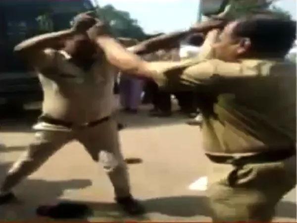 Cops Beating Hurling Shoes Each Other At Maharashtras Bhandara - Sakshi