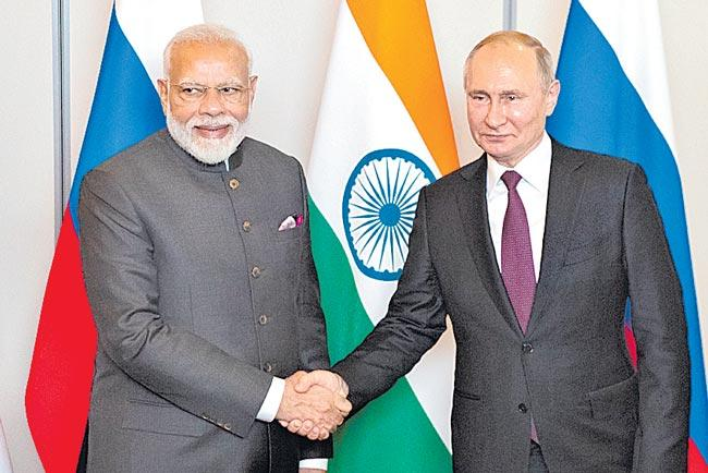 PM Modi Meets Russian President Vladimir Putin in Brazil - Sakshi