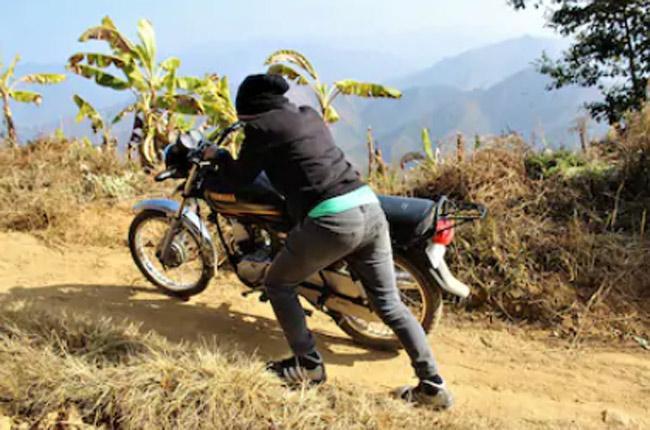 Man Pushing Bike Sans Engine Fined for no Helmet in Tamil Nadu - Sakshi
