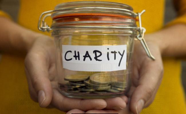 India Much Behind in Charity - Sakshi