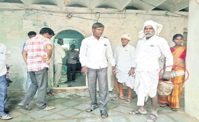 Farmer to tahsildar office with petrol - Sakshi