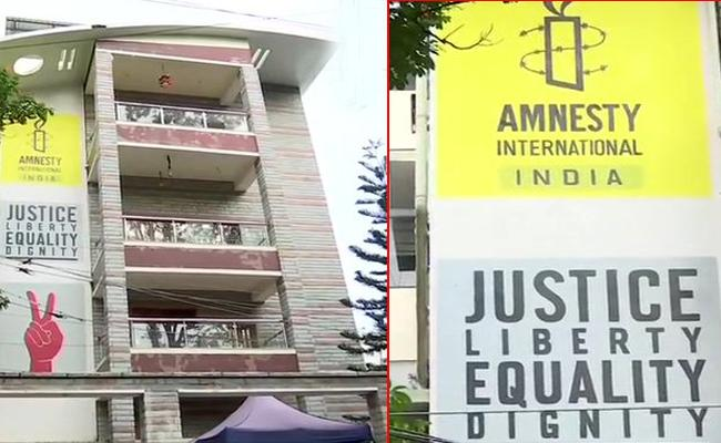 CBI raids Amnesty International India office in Bengaluru - Sakshi