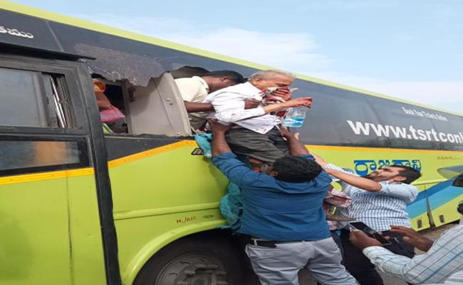 RTC Bus accident In Adilabad - Sakshi