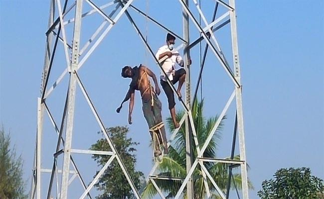 Odisha Man Commits Suicide by Climbing High Tension Tower - Sakshi