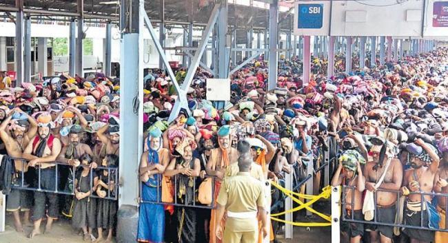 Devotees Visiting Sabarimala Without Any Fear - Sakshi