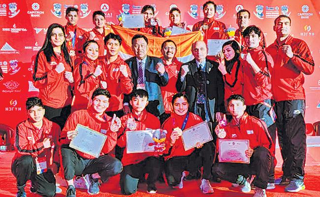 Indian Boxers With 12 Medals In Asian Youth Boxing - Sakshi