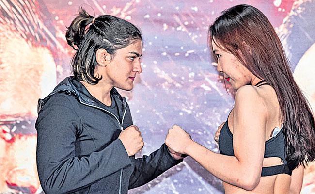 Ritu Phogat knocks Out Kim Nam Hee To Win On MMA Debut - Sakshi