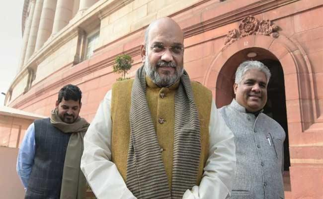 Amit Shah Says NRC Will Be Implemented Throughout India - Sakshi
