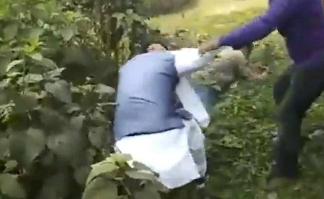 West Bengal Bye Election:Bengal BJP leader kicked By Trinamool workers - Sakshi