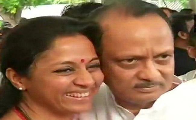 Supriya Sule welcomes Ajit Pawar with a hug - Sakshi