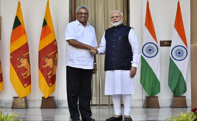 narendra Modi Announces Financial Assistance To sri Lanka - Sakshi