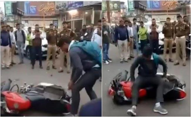 Viral Video About Meerut Man Throws Bike After Fined For Not Wearing Helmet - Sakshi