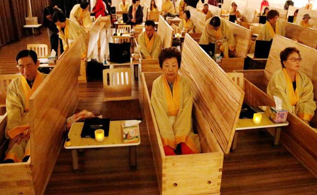 South Koreans Placed Inside Coffins To Simulate Death - Sakshi