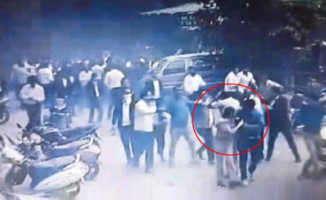 Delhi Lawyers Police Clash CCTV Footage Rescued Woman Police Officer - Sakshi